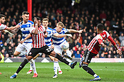 Queens Park Rangers Defender Jake Bidwell (3) takes a shot at goal during the EFL Sky Bet Championship match between Brentford and Queens Park Rangers at Griffin Park, London, England on 2 March 2019.