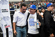 "Oscar De La Hoya visits with Jose ""Chepo"" Reynoso, the boxing coach for Canelo Alvarez, after the weigh-ins at AT&T Stadium in Arlington, Texas on September 16, 2016.  (Cooper Neill for ESPN)"