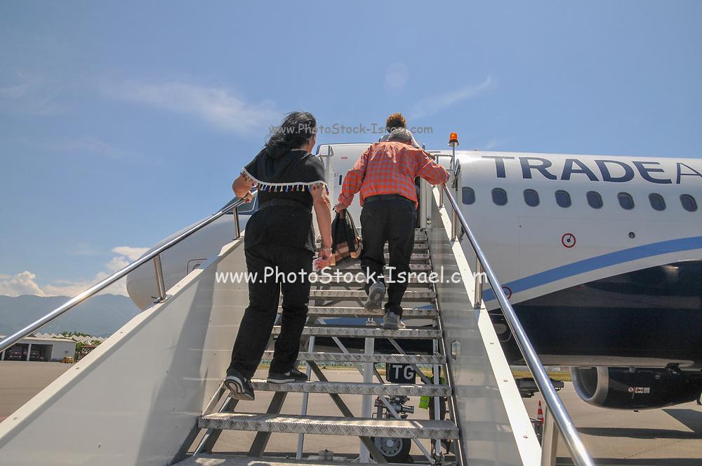 Passengers boarding a plane at Batumi international airport, Georgia