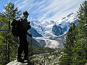 """Morteratsch Glacier (Romansh: Vadret da Morteratsch) flows from Bernina massif in Upper Engadine, Graubünden (Grisons) canton, Switzerland, the Alps, Europe. A favorite walk is from Morteratsch (second train stop from Pontresina towards Bernina Pass) to Refuge Boval, which has a restaurant and overnight lodging. The trail is well graded, 5 or 6 miles round trip with 2700 feet gain. Return via lower trail for partial loop. The Swiss valley of Engadine translates as the """"garden of the En (or Inn) River"""" (Engadin in German, Engiadina in Romansh, Engadina in Italian). Photo by Carol Dempsey."""
