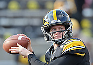 November 02 2013: Iowa Hawkeyes quarterback Jake Rudock (15) warms up before the start of the NCAA football game between the Wisconsin Badgers and the Iowa Hawkeyes at Kinnick Stadium in Iowa City, Iowa on November 2, 2013. Wisconsin defeated Iowa 28-9.