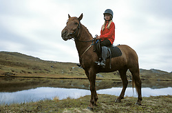 Woman on horseback.<br />