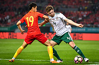 Ben Davies, right, of Wales national football team kicks the ball to make a pass against Wei Shihao of Chinese national men's football team in the semi-final match during the 2018 Gree China Cup International Football Championship in Nanning city, south China's Guangxi Zhuang Autonomous Region, 22 March 2018.