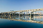 Downtown Little Rock Arkansas as scene from the North Little Rock side of the Arkansas River with the Interstate 30 bridge and a fisherman