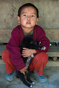 Nyshi child & puppy<br /> Nyshi Tribe<br /> Arunachal Pradesh<br /> North East India