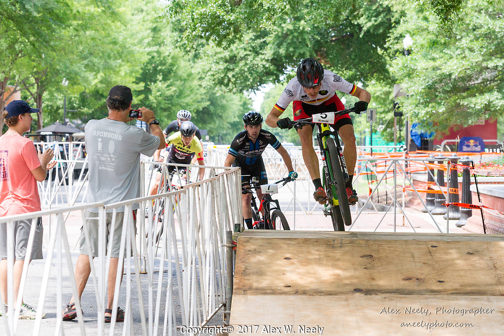 Simon Gegenheimer (#5 GER) leads Hunter Resek (#7 USA), Daniel Castillo Noyola (# 6 MEX) and Matt Clements (8 USA) over the last bump during the first lap of the samll finals at the UCI Mountain Bike Eliminator World Cup held in  Columbus, GA ,USA on June 4, 2017.
