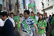 Hiroya Masuda, a major candidate for Tokyo gubernatorial election walks with supporters in Ginza,Tokyo. The former internal affairs minister has the backing of the Liberal Democratic Party, Komeito and the Party for the Japanese Kokoro in the July 31 election. 18/07/2016-Tokyo, JAPAN