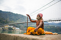Sadhuji meditating at the Ganga, in front of Ram Jula, Rishikesh - India