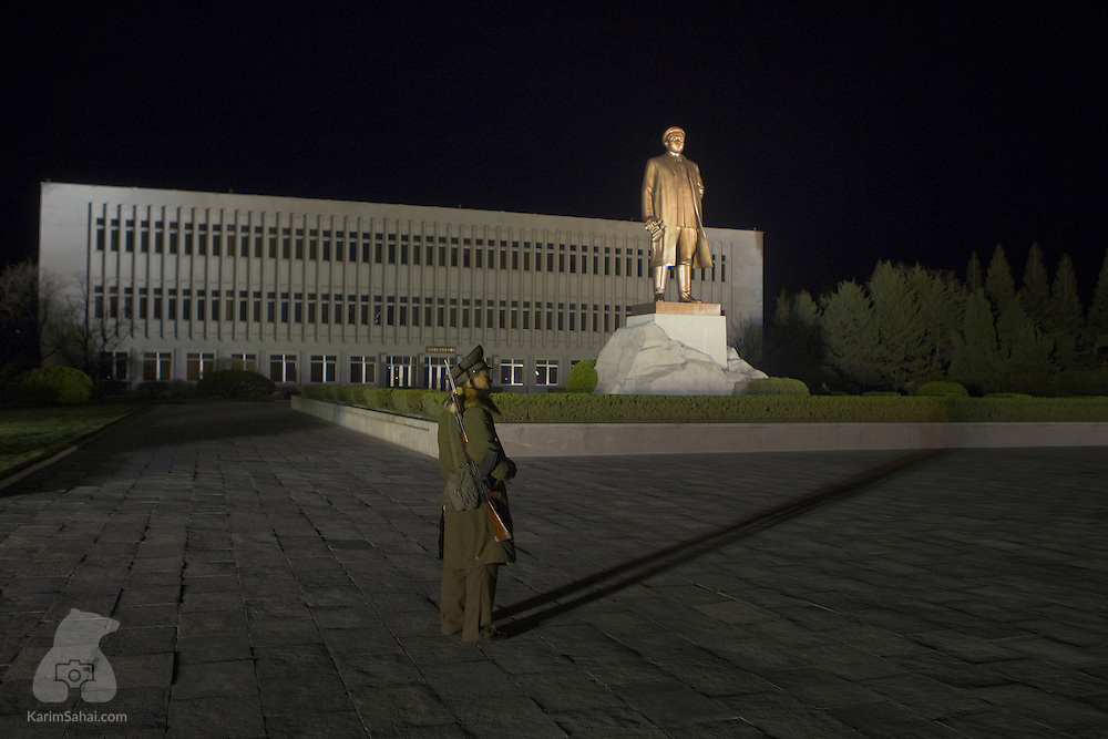 A soldier guards a large statue of the late leader Kim Jong Il, in Wonsan, North Korea.