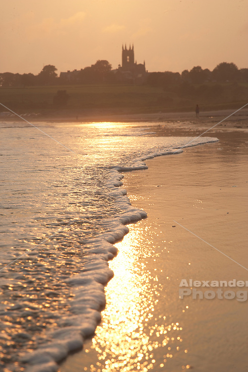 Afternoon sun reflects on shore break at second beach, st Georges church in background, Middletown, RI
