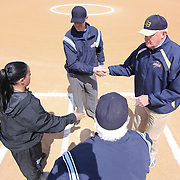Post University Manager Tracey Garofalo (LEFT) and Goldey-Beacom Manager Bill Streets (Right) shake hands with umpires prior to game #1 of NCAA Central Atlantic Collegiate Conference (doubleheader) between Goldey-Beacom and Post University Saturday, March 30, 2013, at Nancy Churchmann Sawin Athletic Field in Wilmington Delaware.