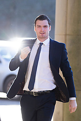 © Licensed to London News Pictures. 23/02/2016. Bradford UK. Adam Johnson arrives at Bradford Crown Court this morning. The former Sunderland player who denies two counts of sexual activity with a child has begun giving evidence in his trial. The footballer has previously pleaded guilty to one count of sexual activity with a child and one charge of grooming. He was sacked by Sunderland as a result. Photo credit: Andrew McCaren/LNP