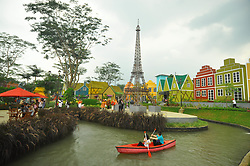April 17, 2018 - Bogor, West Java, Indonesia - After successfully won the title of The Most Lovable City of this world, Bogor city certainly has many advantages. One of them is tourism sector. Besides having culture of China and Arab village, Bogor city also has Europe village, located on Jl Boulevard Bogor Nirwana Residence, Mulyaharja, South of Bogor, Bogor City, West Java. This European-style tourist resort stands on an area of 1.8 hectares. With the concept of holiday, selfie and foodies, some of the iconic buildings from some countries present here such as Eiffel Tower, the Windmill House, and the Venetian Gondola. Not only recreation, visitors can also shopping souvenirs or try the typical European food here. Other than that, visitors can try the game Brotherhood and The Magic of Kettles, which presents Robin Hood and Hansel and Gretel adventures. (Credit Image: © Andi Muh Ridwan/Pacific Press via ZUMA Wire)