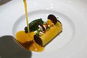 Berlin, Germany. Restaurant Tim Raue.<br /> SELLERIE schwarzer Trüffel | Kopfsalat