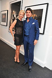 TAMARA BECKWITH and her husband GEORGiO VERONI at a private view of an exhibition of photographs by Mike Figgis entitled 'Kate & Other Women' held at The Little Black Gallery, 13 A Park Walk, London SW10 on 22nd June 2011.
