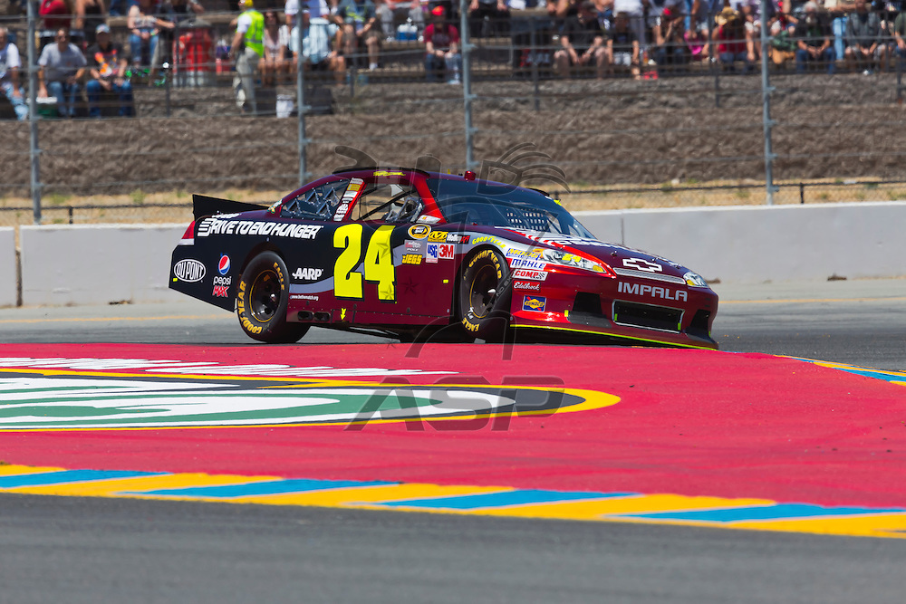 SONOMA, CA - JUN 24, 2012: Jeff Gordon (24) brings his car through the turns during the Toyota Save Mart 350 at the Raceway at Sonoma in Sonoma, CA.