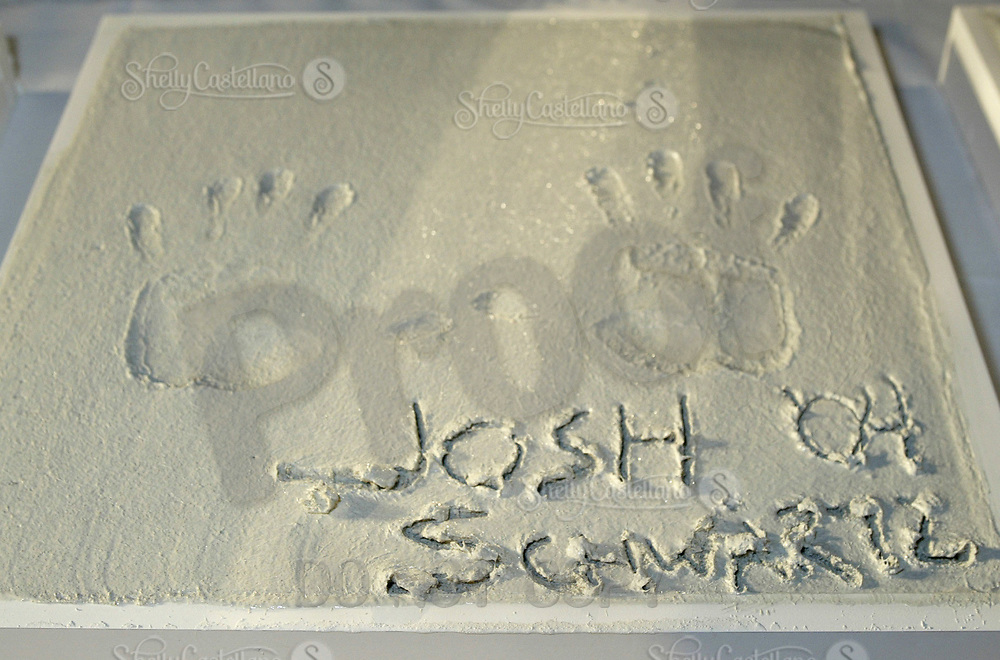 Oct 28, 2004; Newport Beach, CA, USA; Creator JOSH SCHWARTZ for the FOX hit TV show 'The OC' visited the Balboa Penninsula in Newport Beach to get a Key to the City and be immortalized in cement with thier hand prints to be placed at the enterance to the Historic Balboa Pavillion. These are Josh's hand print and signature in cement.  Mandatory Credit: Photo by Shelly Castellano/ZUMA Press.