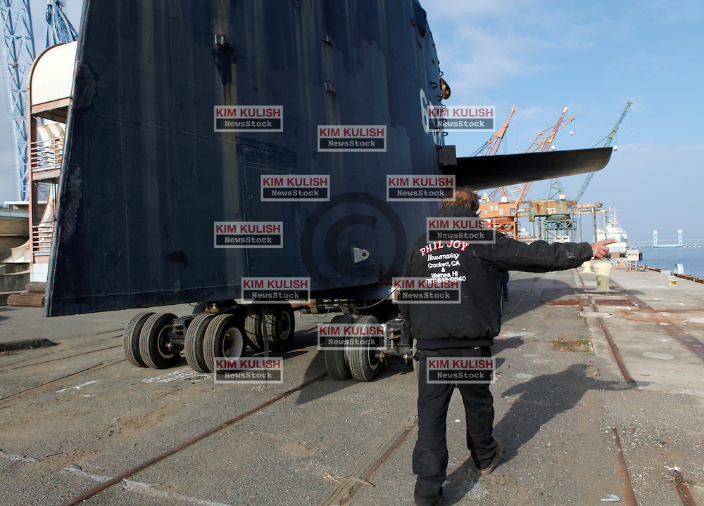 The 40-foot tall submarine conning tower and sail from the USS Mariano G. Vallejo submarine is moved to it's new home on Mare Island.  Phil Joy, a house mover from Benicia, donated his expertise, crew and equipment  to slowly move the 65 ton-sail between buildings and along California Avenue to its new location at Building Waterways 2 adjacent to historic Dry Dock 1.  Local residents, workers and business owners gathered to watch history from the cold-war era pass by.