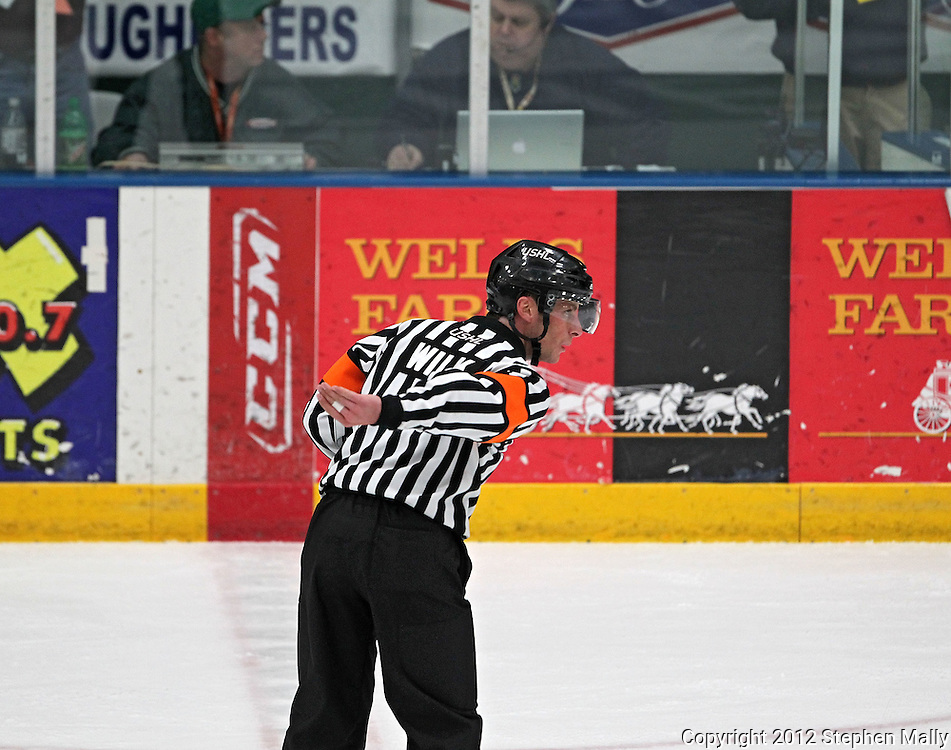 Referee Andrew Wilk signals a tripping penalty during the game at the Cedar Rapids Ice Arena, 1100 Rockford Road SW in Cedar Rapids on Saturday evening, February 18, 2012. (Stephen Mally/Freelance)