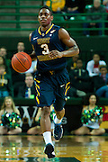 WACO, TX - JANUARY 28: Juwan Staten #3 of the West Virginia Mountaineers brings the ball up court against the Baylor Bears on January 28, 2014 at the Ferrell Center in Waco, Texas.  (Photo by Cooper Neill/Getty Images) *** Local Caption *** Juwan Staten