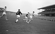 Dublin player runs while in possession of the ball as Galway players are behind him during All Ireland Senior Gaelic Football Championship Final Dublin V Galway at Croke Park on the 22nd September 1963. Dublin 1-9 Galway 0-10.