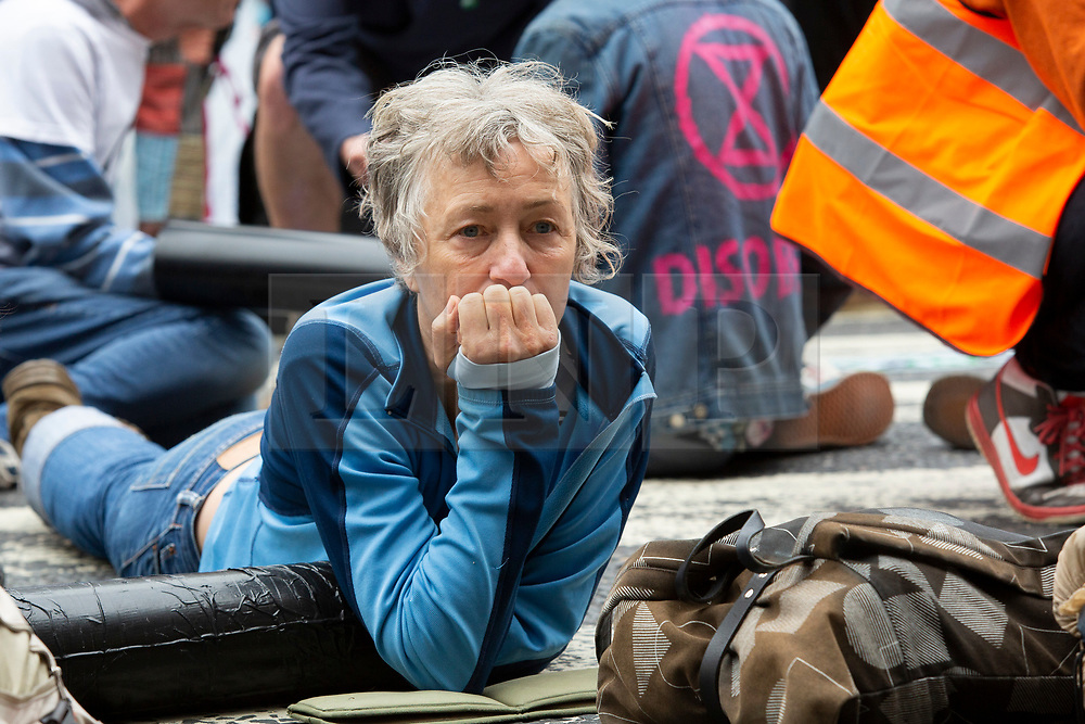 © Licensed to London News Pictures. 15/07/2019. London, UK.A Extinction Rebellion protester locks on outside The Royal Courts of Justice. They are campaigning against climate change.  Photo credit: George Cracknell Wright/LNP