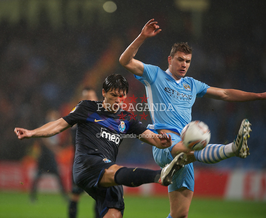 MANCHESTER, ENGLAND - Wednesday, February 22, 2012: Manchester City's Edin Dzeko in action against FC Porto's Cristian Sapunaru during the UEFA Europa League Round of 32 2nd Leg match at City of Manchester Stadium. (Pic by David Rawcliffe/Propaganda)