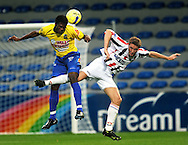 05-09-2008 Voetbal:KVC Westerlo:Willem II: Westerlo<br /> Jaimi Ruiz kopt de bal weg voor Rens van Eijden<br /> Foto: Geert van Erven