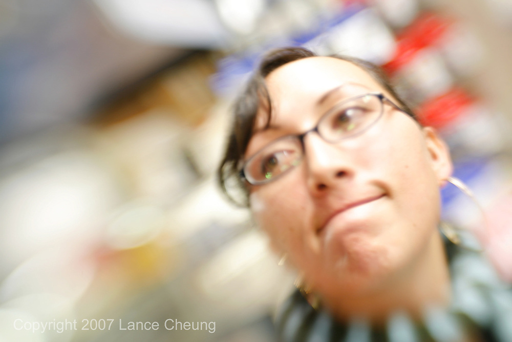 Sabrina Cheung considers what camera bag is best for her while at Loooking Glass Photo, Berkeley, CA on Jan 8, 2007<br />