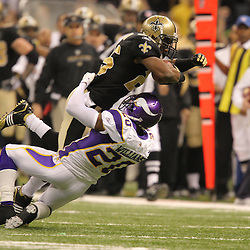 Jan 24, 2010; New Orleans, LA, USA; New Orleans Saints running back Reggie Bush (25) over Minnesota Vikings safety Madieu Williams (20) during the second quarter of the 2010 NFC Championship game at the Louisiana Superdome. Mandatory Credit: Derick E. Hingle-US PRESSWIRE