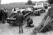 A46 protesters getting their car towed by a truck, Solsbury Hill, Somerset, UK, 1994.