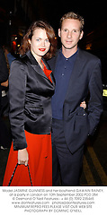 Model JASMINE GUINNESS and her boyfriend GAWAIN RAINEY, at a party in London on 10th September 2002.PDD 284
