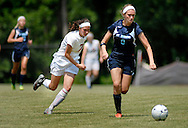 26 MAY 2012 -- TOWN & COUNTRY, Mo. -- St. Dominic High School soccer player Paige Whitehead (0) pushes the ball upfield past Visitation Academy player Hannah Brobst (7) during the MSHSAA Class 2 girls' soccer quarterfinals at Visitation Saturday, May 26, 2012. St. Dominic topped the Vivettes 8-1 to advance to Friday's semifinals against Helias Catholic High School at Blue Springs South High School. Photo © copyright 2012 Sid Hastings.