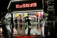 Rainy night in Yurakucho outside BIC camera store. Tokyo.