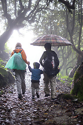 THEMENBILD - Trekkingtour in Nepal um die Annapurna Gebirgskette im Himalaya Gebirge. Das Bild wurde im Zuge einer 210 Kilometer langen Wanderung im Annapurna Gebiet zwischen 01. September 2012 und 15. September 2012 aufgenommen. im Bild Eine Familie wandert während der Monsoon Zeit durch einen Dschungelpfad // THEME IMAGE FEATURE - Trekking in Nepal around Annapurna massif at himalaya mountain range. The image was taken between september 1. 2012 and september 15. 2012. Picture shows Family at jungle path at monsoon, NEP, EXPA Pictures © 2012, PhotoCredit: EXPA/ M. Gruber