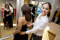 Salesperson Assisting Woman with Cocktail Dress