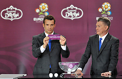 (L) ANDRIY SCHEVCHENKO SHOWS THE TICKET OF SWITZERLAND AND (R) OLEG BLOCHIN (BOTH UKRAINE) DURING THE EUFA EURO 2012 QUALIFYING DRAW IN PALACE SCIENCE AND CULTURE IN WARSAW, POLAND..THE 2012 EUROPEAN SOCCER CHAMPIONSHIP WILL BE HOSTED BY POLAND AND UKRAINE...WARSAW, POLAND , FEBRUARY 07, 2010..( PHOTO BY ADAM NURKIEWICZ / MEDIASPORT / SPORTIDA.COM ).
