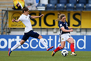 Erin Cuthbert (#22) of Scotland crosses the ball beyond the outstretched leg of Elvira Urazaeva (#8) of Belarus during the FIFA Women's World Cup UEFA Qualifier match between Scotland Women and Belarus Women at Falkirk Stadium, Falkirk, Scotland on 7 June 2018. Picture by Craig Doyle.