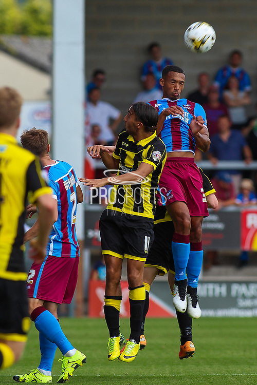 Abdenasser El Khayati and Jordan Clarke during the Sky Bet League 1 match between Burton Albion and Scunthorpe United at the Pirelli Stadium, Burton upon Trent, England on 8 August 2015. Photo by Aaron Lupton.