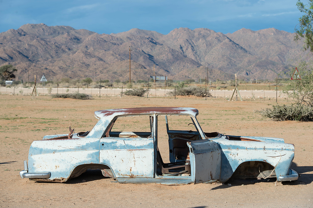 The frame of an antique car is left behind in the small town of Solitaire, Namibia, just outside of the Namib desert.