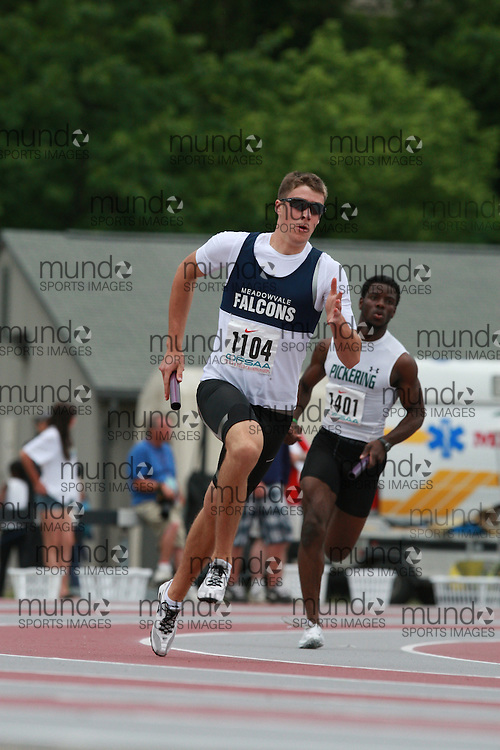 (London, Ontario}---04 June 2010) Kevin MacDonald of Meadowvale - Mississauga competing in the 4x400m relay heats at the 2010 OFSAA Ontario High School Track and Field Championships in London, Ontario, June 04, 2010 . Photograph copyright Dave Chidley / Mundo Sport Images, 2010.