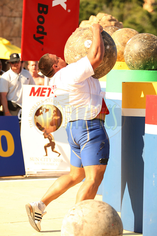 Mikhail Koklyaev (Russia) shows good skill and pace placing one of the Atlas Stones on the platform during the final rounds of the World's Strongest Man competition held in Sun City, South Africa.