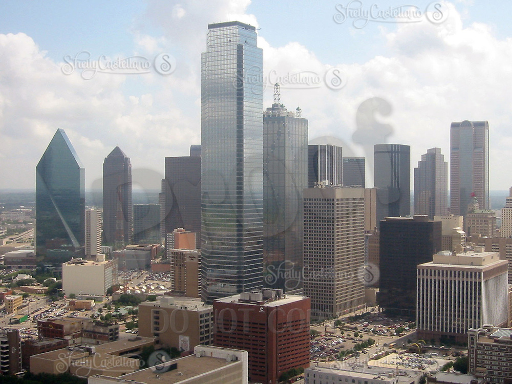 Jun 21, 2002; Dallas, TX, USA; Downtown Dallas on a partially cloudy day. Tall skyscrapers tower over older buildings in the area.  Mandatory Credit: Photo by Shelly Castellano/ZUMA Press. (©) Copyright 2002 by Shelly Castellano