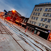Kansas City streetcar line construction along Main Street in the Crossroads District area, downtown Kansas City, Missouri. Dilapidated Hotel Midwest Building at right.