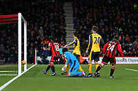 Football - 2016 / 2017 Premier League - AFC Bournemouth vs. Arsenal<br /> <br /> Bournemouth's Ryan Fraser squeezes the ball past Petr Cech of Arsenal to score Bournemouths third at Dean Court (The Vitality Stadium) Bournemouth<br /> <br /> COLORSPORT/SHAUN BOGGUST