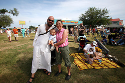 April 27 2007. New Orleans, Louisiana. <br /> The New Orleans Jazz and Heritage Festival. Jonathan Ferrara with Ben and Michelle at the festival. Ben's second Jazzfest - this time out of the womb! <br /> Photo credit; Charlie Varley/varleypix.com