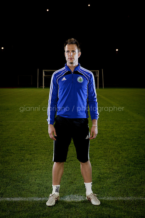 SERRAVALLE, SAN MARNO - 3 OCTOBER 2011:  Federico Valentini, 29, who works as a bank clerk and plays as backup goalkeeper in the San Marino national team, poses at the Olympic Stadium before the upcoming and last Euro 2012 qualification game against Moldova on October 11, in San Marino on October 3, 2011. Before a recent game against Sweden, the starting keeper got hurt, so they called Valentini in the bank in the morning to ask if he could play. He did, and played well. The San Marino national football team is the last team in the FIFA  World Ranking (position 203). San Marino, whose population reaches 30,000 people, has never won a game since the team was founded in 1988. They have only ever won one game, beating Liechtenstein 1&ndash;0 in a friendly match on 28 April 2004. The Republic of San Marino, an enclave surronded by Italy situated on the eastern side of the Apennine Moutanins, is the oldest consitutional republic of the world<br /> <br /> <br /> ph. Gianni Cipriano