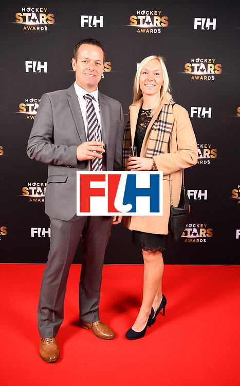 BERLIN, GERMANY - FEBRUARY 05:  John Wright  of South Africa and Sarah Wilson of Scotland pose for a picture during the Hockey Star Awards night at Stilwerk on February 5, 2018 in Berlin, Germany.  (Photo by Stuart Franklin/Getty Images For FIH)