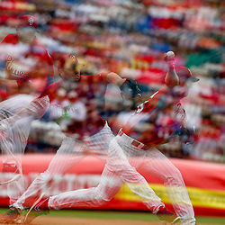 Mar 12, 2013; Clearwater, FL, USA; (editors note: multiple exposure image) Philadelphia Phillies starting pitcher Roy Halladay (34) throws against the Detroit Tigers during the top of the third inning of a spring training game at Bright House Field. Mandatory Credit: Derick E. Hingle-USA TODAY Sports