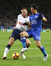 Leicester City's Shinji Okazaki (right) and Tottenham Hotspur's Eric Dier battle for the ball during the Premier League match at the King Power Stadium, Leicester.